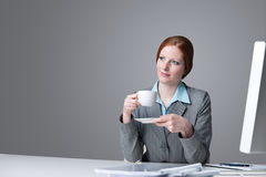 Successful business woman having coffee break. At office Stock Photography