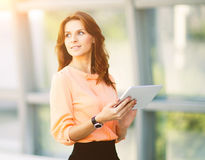 Successful business woman holding a digital tablet computer in the office Royalty Free Stock Image