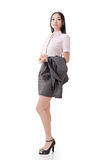 Successful business woman. Holding her coat, full length portrait isolated on white background Royalty Free Stock Photos