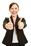 Successful business woman holding thumbs up Stock Photos