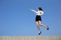 Successful business woman jump Royalty Free Stock Image