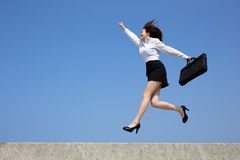 Successful business woman jump Royalty Free Stock Images