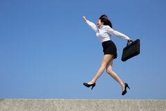 Successful business woman jump Stock Photography