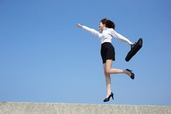 Successful business woman jump Stock Images