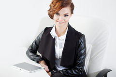 Successful business woman looking confident and Stock Photos