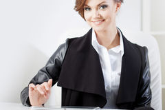 Successful business woman looking confident and Royalty Free Stock Image