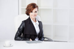 Successful business woman looking confident and Stock Image