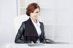 Successful business woman looking confident and Royalty Free Stock Photography