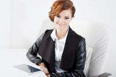 Successful business woman looking confident and Royalty Free Stock Photos