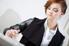 Successful business woman, looking at the laptop Stock Photography
