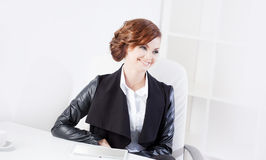 Successful business woman looking to the right and Stock Photography