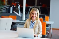 Successful business woman and man working at the office.  stock images