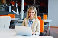 Successful business woman and man working at the office.  royalty free stock photos