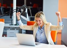 Successful business woman and man working at the office.  royalty free stock image