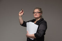 Successful business woman of middle age with important documents Royalty Free Stock Images