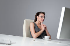 Successful business woman at office. Having cup of coffee sitting at computer desk Royalty Free Stock Photo