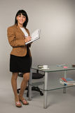 Successful business woman in a office. Happy successful business woman in a office Royalty Free Stock Photos
