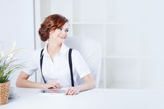 Successful business woman in the office looking Royalty Free Stock Photo