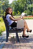 Successful business woman in park outdoor Stock Photo