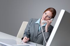 Successful business woman on the phone Royalty Free Stock Photos