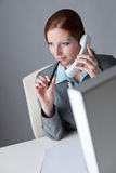 Successful business woman on the phone. Calling at office Royalty Free Stock Image