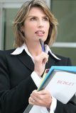 Successful Business Woman Planning Budget. Successful business woman or politician planning a budget Stock Image