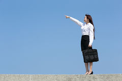 Successful business woman pointing Royalty Free Stock Photos