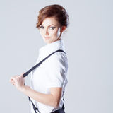 Successful business woman, pulls suspenders and Royalty Free Stock Photos