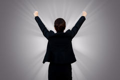 Successful business woman raising hand royalty free stock photos
