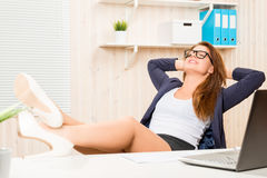Successful business woman relaxing at his desk Stock Image