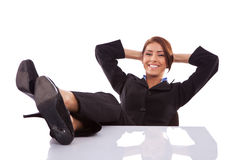 Successful business woman resting. At her desk on white background stock photo