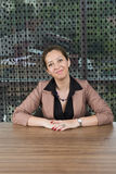 Successful business woman sitting at desk. At the office Royalty Free Stock Image