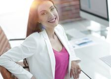 Successful business woman smiling customer. Female accountant, drawn to the client sitting at your Desk Royalty Free Stock Image