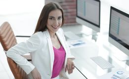 Successful business woman smiling customer. Female accountant, drawn to the client sitting at your Desk Stock Photo