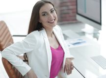 Successful business woman smiling customer. Female accountant, drawn to the client sitting at your Desk Royalty Free Stock Images