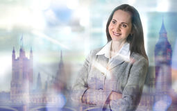 Successful business woman smiling portrait and Big Ben reflection in the glass Stock Photos