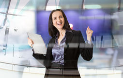 Successful business woman smiling portrait with note pad. Portrait in office against glass reflection Stock Photography