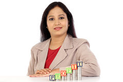 Successful business woman with stack of coins Royalty Free Stock Photos
