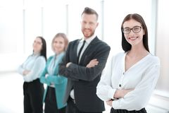 Successful business woman standing in front of her business team stock photography