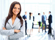 Successful business woman standing with her staff. In background at office royalty free stock images