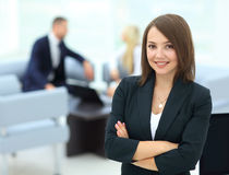 Successful business woman standing with her staff in background Royalty Free Stock Photos