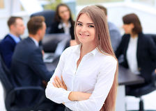 Successful business woman standing with his staff in background at office Royalty Free Stock Photo
