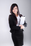 Successful Business woman. Studio shot of a successful business woman holding a file Royalty Free Stock Image