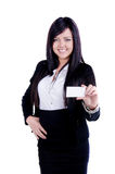 Successful Business woman. Studio shot of a successful business woman showing business card Royalty Free Stock Photography