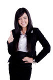 Successful Business woman. Studio shot of a successful business woman with thumbs up and smiling Stock Photo