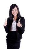 Successful Business woman. Studio shot of a successful business woman with two thumbs up and smiling Royalty Free Stock Photo
