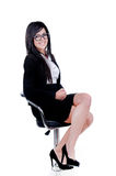 Successful Business woman. Studio shot of a successful business woman wearing nerd glasses sitting down Stock Photo