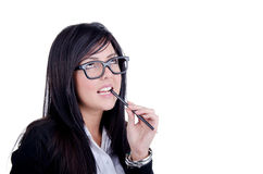 Successful Business woman. Studio shot of a successful business woman wearing nerd glasses smiling and biting a pencil Stock Photography