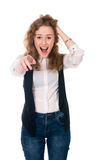 Successful business woman surprised and shows a finger at the ca Stock Image