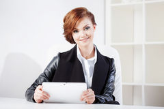Successful business woman with tablet  looking Royalty Free Stock Image